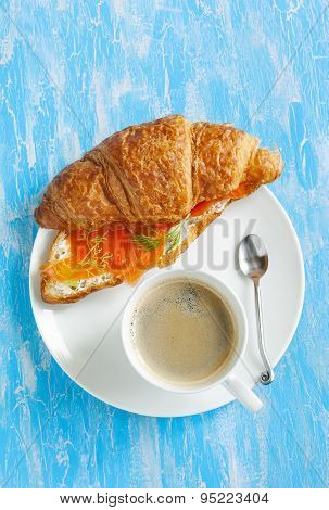 Croissant With Salmon And Cup Of Coffee.
