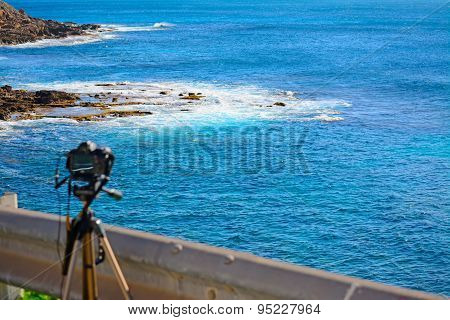 Dslr Camera On Tripod By The Sea In Alghero