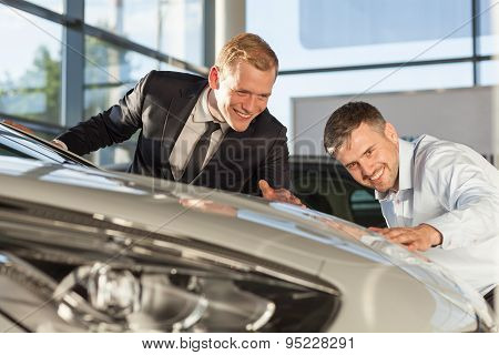 Mature Man Admiring Expensive Vehicle