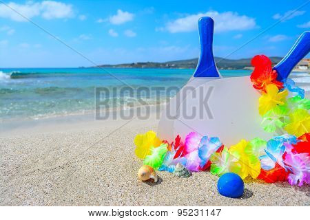 Rackets And Shells On A Tropical Beach