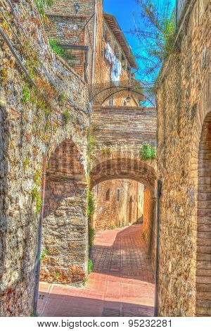 Arches In A Narrow Street In San Gimignano