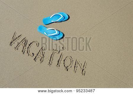 Blue Pair Of Slippers On A Sea Shore