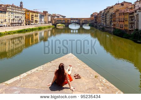 Florence. Woman Tourist Admires The Ponte Vecchio.