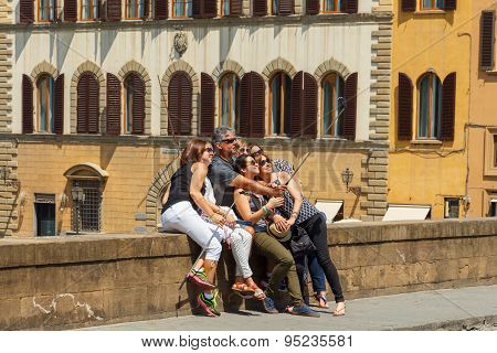 Florence. A Group Of Tourists On The Bridge Making Self.
