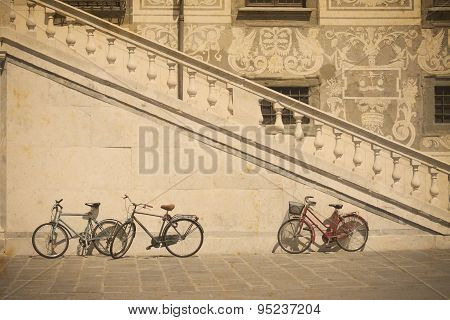 Bicycle By An Historic Stairway In Pisa In Vintage Tone