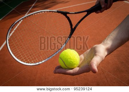 Hand Holding Tennis Racket And Ball On Court
