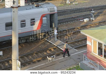 Conductor Standing Near The Car Before The Departure Of A Passenger Train From The Station