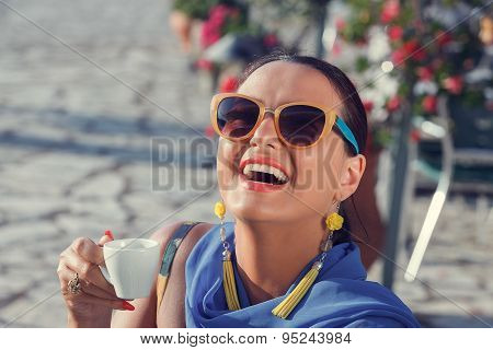 Young woman having a great time in a coffee shop