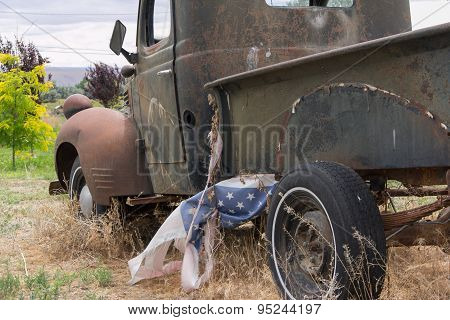 Old rusty truck with flag