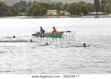 Rescuers In The Lake.