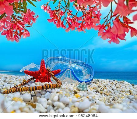 Diving Mask And Flowers By Th Sea