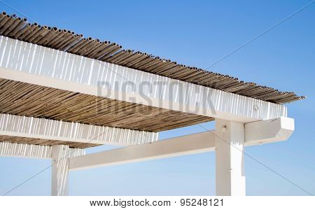Wooden And Bamboo Gazebo Roof Over Summer Blue Sky