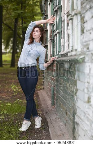 Girl Student About An Abandoned House In The Park After School.