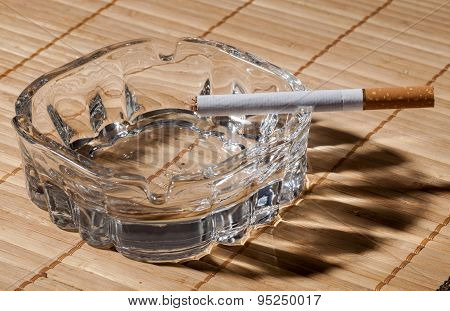 Cigarette With Brown Filter And Ashtray