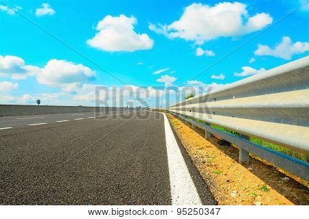 Guard Rail Under Clouds