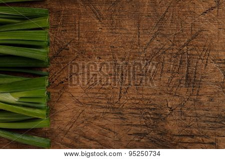 Green Onion Sticks On Wooden Table