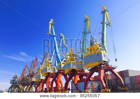 port cranes with blue sky