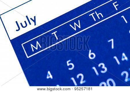 Spiral Bound Calendar Displaying Month Of July.