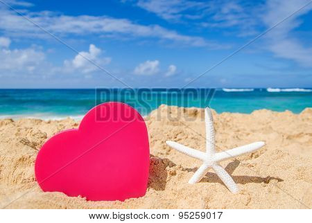 Starfish With Big Heart On The Sandy Beach
