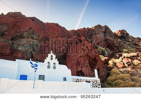 The Church And Red Volcanic Mountains On Red Beach