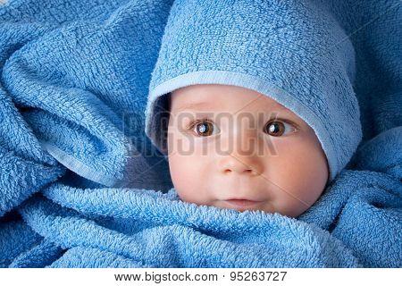 Cute baby in a towel