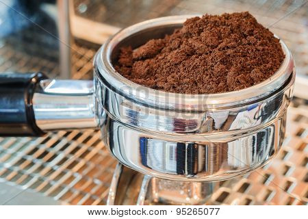 Coffee portafilter filled with finely grounded coffee