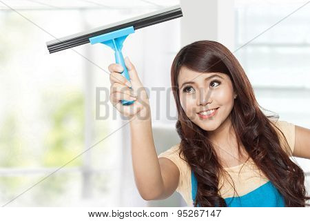 Beautiful Young Asian Woman Doing Domestic Chores With Glass Cle