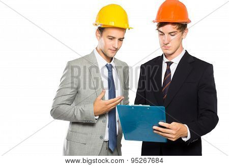 Two Contractor Discussing About Their Construction