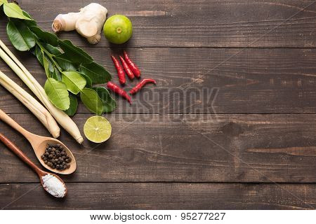 Kaffir Lime Leaves, Ginger, Lemon, Pepper, Salt,  Red Chilli And Green Onions On Wooden Background.