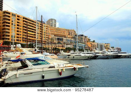Luxury Yachts In The Port Hercules And Cityview In Monte Carlo, Monaco.