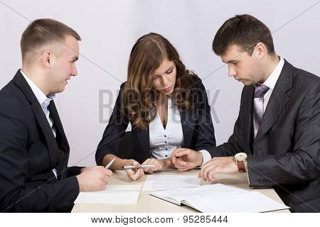 Business people discuss deal