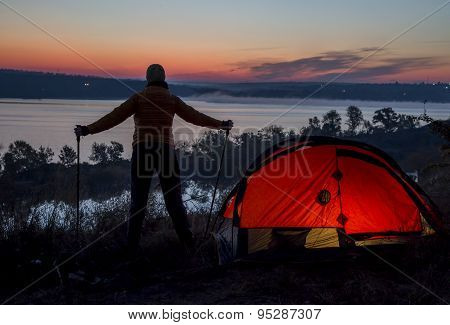 Hiker, tent and sunrise