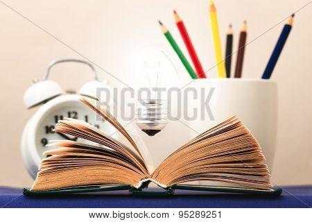 Light On The Book Symbolizes The Idea