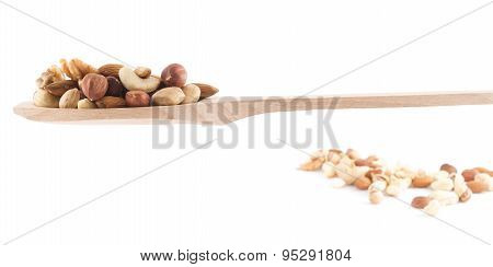 Spoon full of nuts mix over white