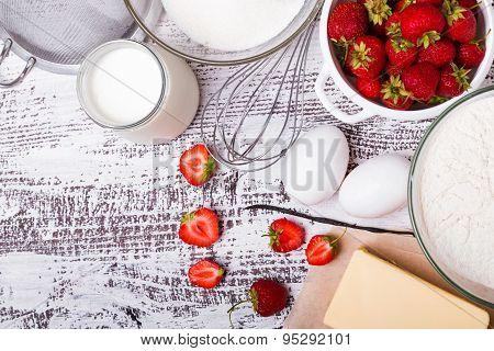 Ingredients For Making Strawberry Yogurt Cake On White Wooden Background.