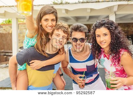 Group of young people having fun in summer party