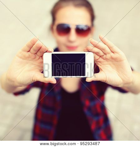 Blank Screen Phone, Woman Makes Self-portrait On The Smartphone, Female Face Blurred, Close-up Hands