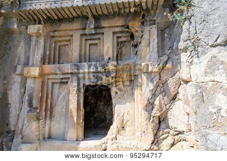 Ancient rock tombs closeup in Turkey