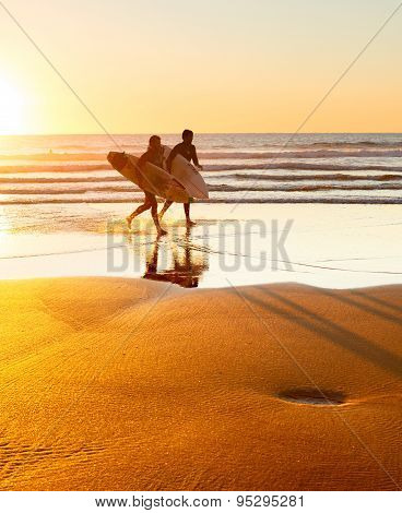 Surfers On The Beach, Portugal