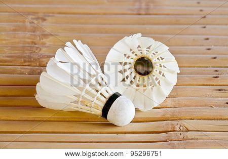 Shuttlecock on bamboo table