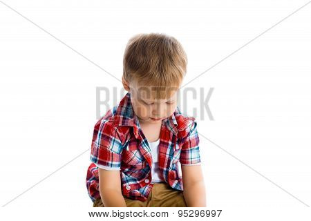 Little Boy In A Plaid Shirt Over A White