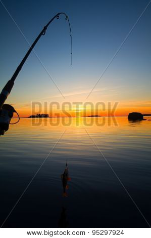 Sunset River Perch Fishing With The Boat And A Rod