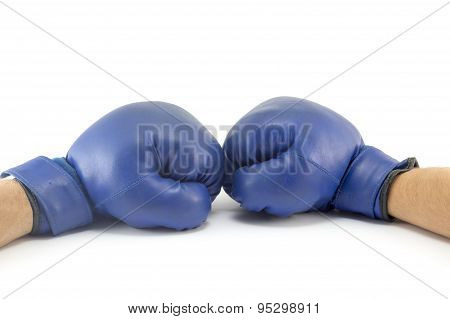 Two Fists In Blue Boxing Gloves Confronting At Each Other