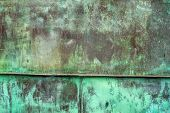 picture of oxidation  - Oxidized Green Copper Metal Plate Texture as Industrial Rustic Background - JPG