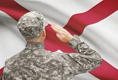 foto of alabama  - Soldier saluting to USA state flag conceptual series  - JPG