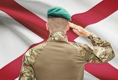 image of alabama  - Soldier saluting to US state flag series  - JPG