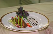 picture of chateaubriand  - fancy chateaubriand on a plate that is elegantly garnished - JPG