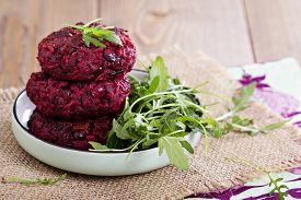 stock photo of veggie burger  - Beetroot vegan burgers with rice and red beans - JPG