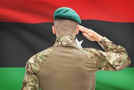 pic of libya  - Soldier in hat facing national flag series  - JPG