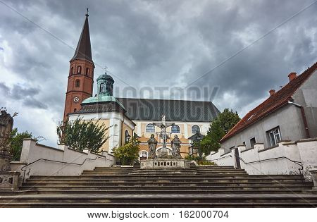 Baroque sculpture on the steps of the church in Grodowcu Poland